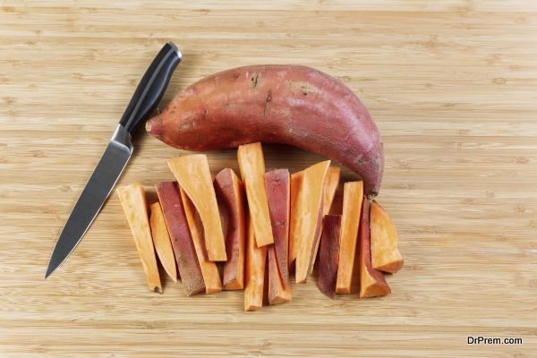 Fresh Yams sliced on Bamboo cutting board