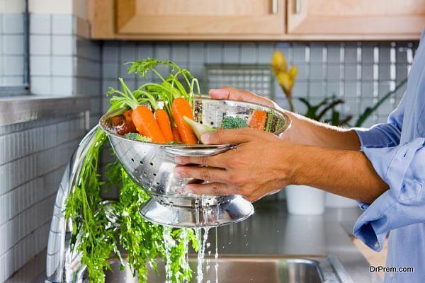 Man Rinsing Carrots
