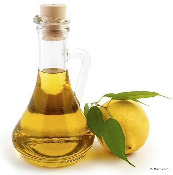 An image of a bottle of olive oil and lemon