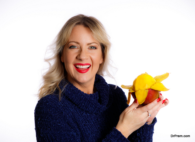 Middle Aged Woman Holding A Mango